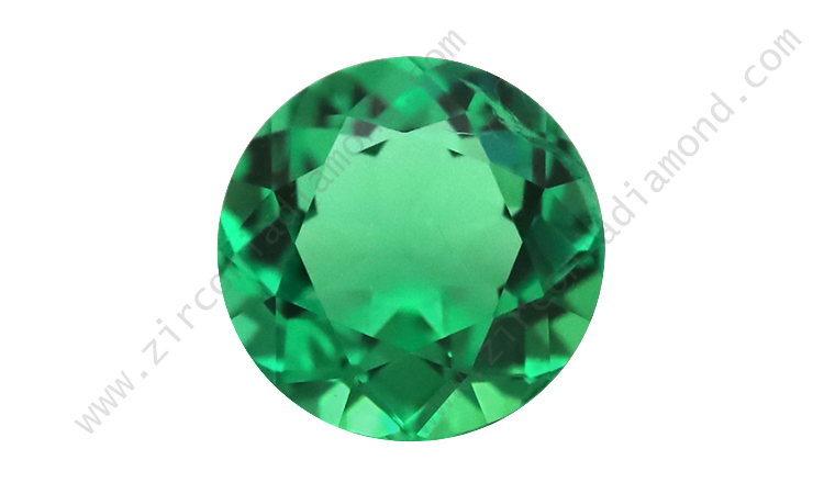 Zirmond round lab created synthetic emerald 1